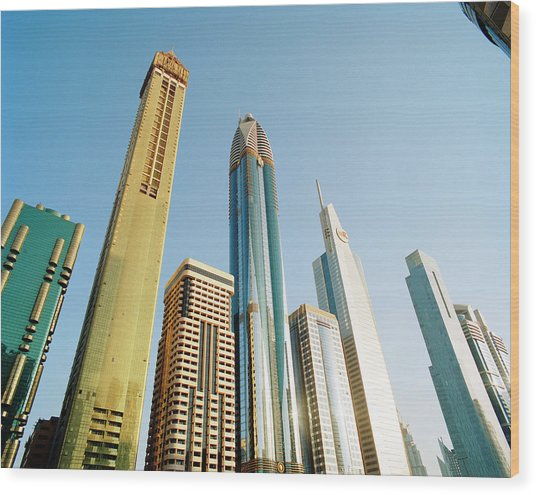 Skyscrapers Along Sheikh Zayed Road At Wood Print by Gary Yeowell