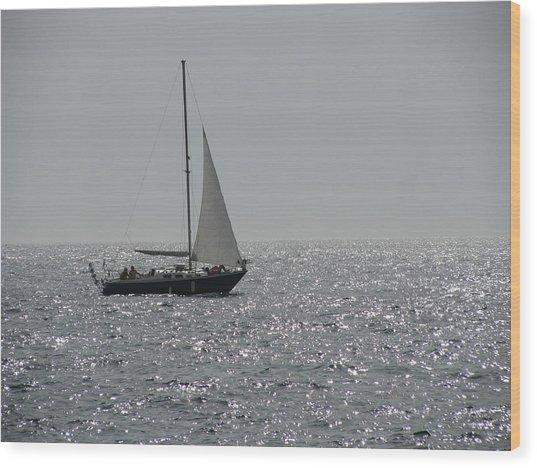 Small Boat At Sea Wood Print