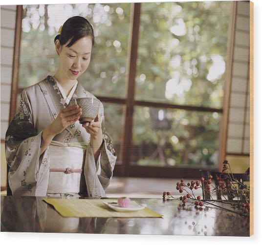 Smiling Woman Drinking Tea During A Japanese Tea Ceremony Wood Print by Digital Vision.