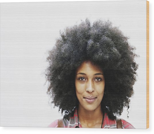 Smiling Woman With Afro Hairstyle Wood Print by Thomas Barwick