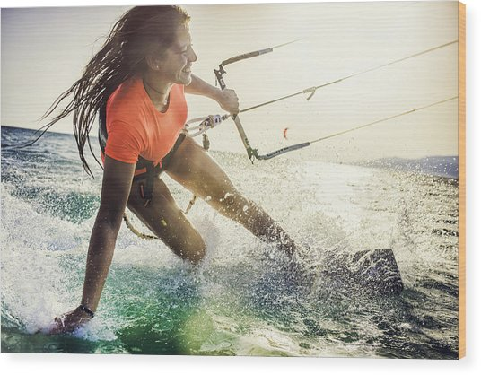 Smiling Young Female Kiteboarder On The Sea Wood Print by Vm