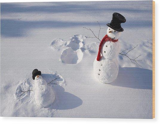 Snowmen In Forest Making Snow Angel Wood Print