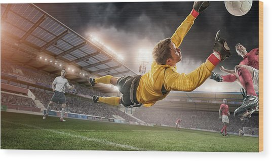 Soccer Goalie In Mid Air Save Wood Print by Peepo