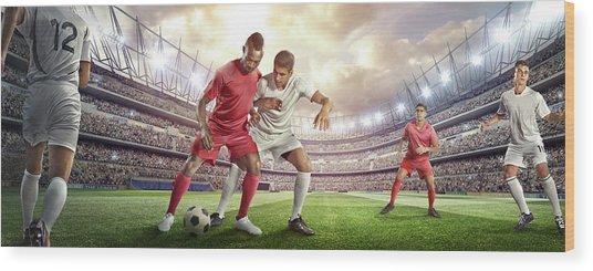 Soccer Player Tackling Ball In Stadium Wood Print by Dmytro Aksonov
