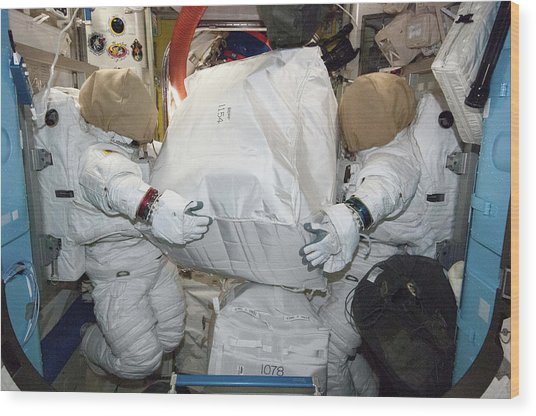 Spacesuits On The Iss Wood Print
