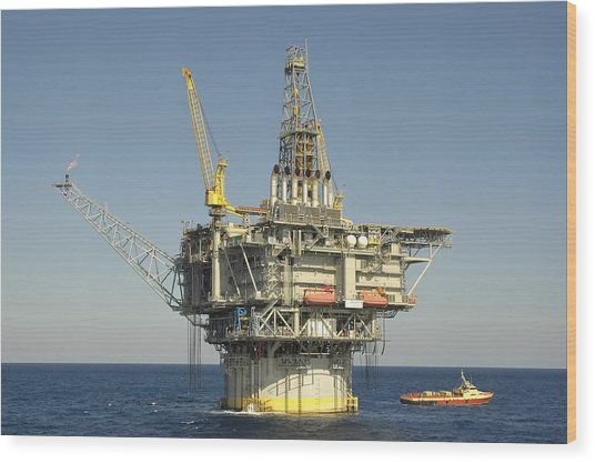Spar Type Oil Rig With Flare And Boat Wood Print