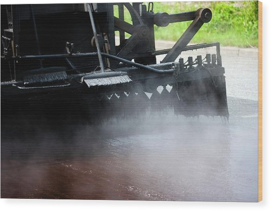 Spraying Bitumen During Road Resurfacing Wood Print by Ian Gowland/science Photo Library
