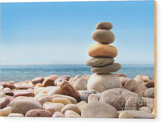 Stack Of Pebble Stones On White Wood Print