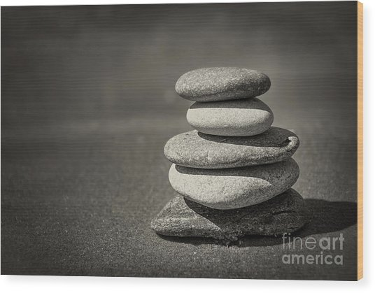 Stacked Pebbles On Beach Wood Print