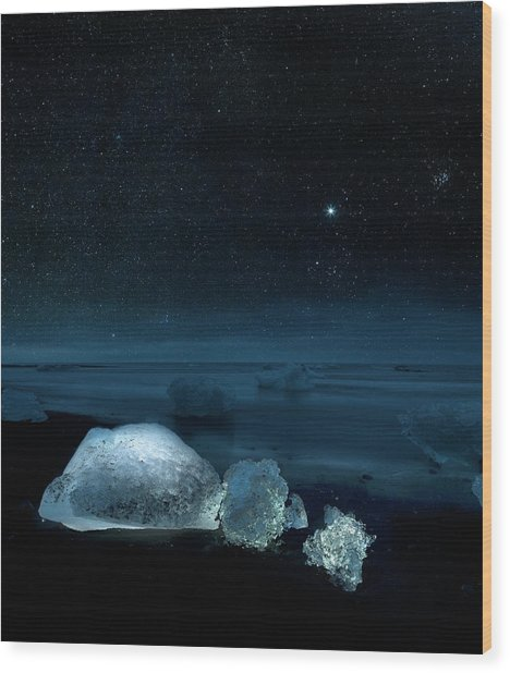 Starry Night Over Ice On Black Sand Wood Print by Arctic-images