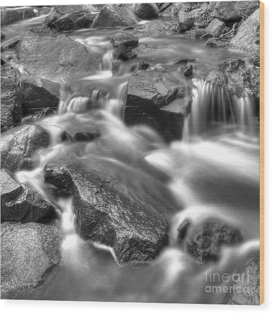 Stream Flowing Over Rocks In Black And White Wood Print