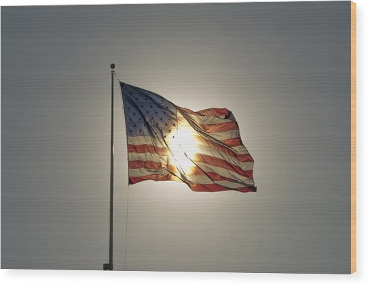 Sun Behind Stars And Stripes Wood Print by Chris Cameron