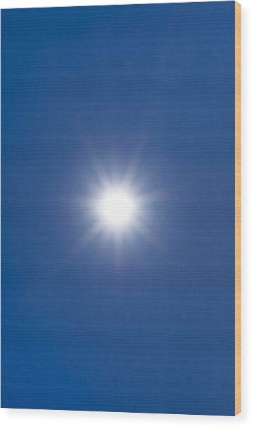 Sun In A Blue Sky Wood Print by Science Photo Library