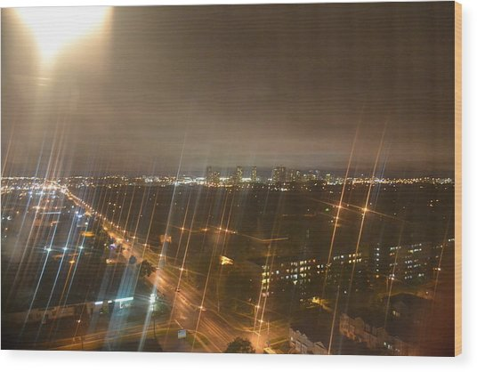 Sun Over City Lights Wood Print by Naomi Berhane