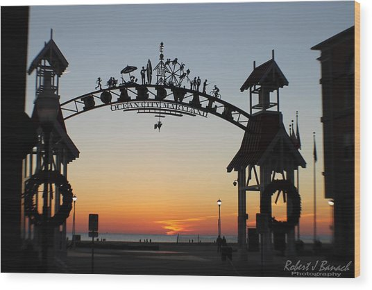 Sun Reflecting On Clouds Ocean City Boardwalk Arch Wood Print