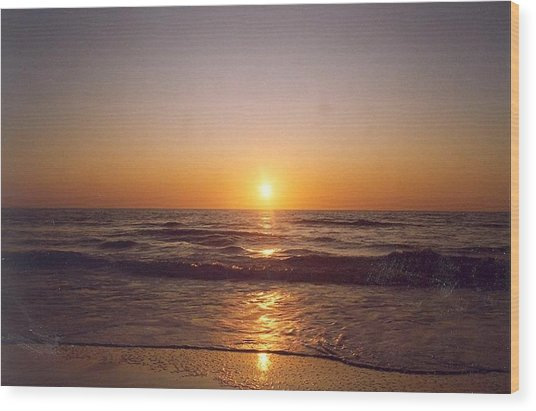 Sun Setting At Ocean Beach Wood Print