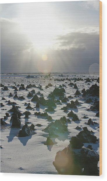 Sun Shining On A Field Of Lava Rocks Wood Print by Thomas Kokta