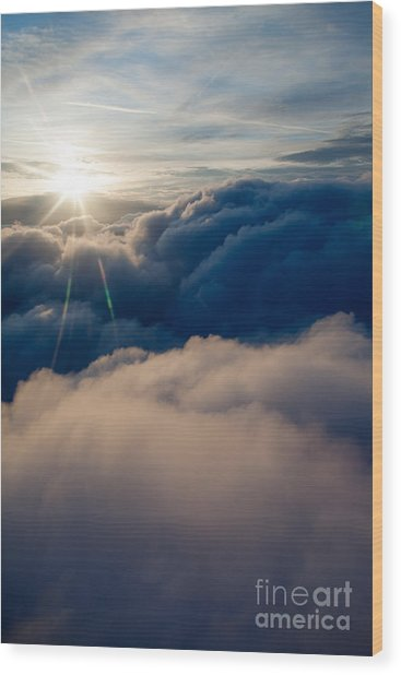 Sunburst Above The Clouds Wood Print
