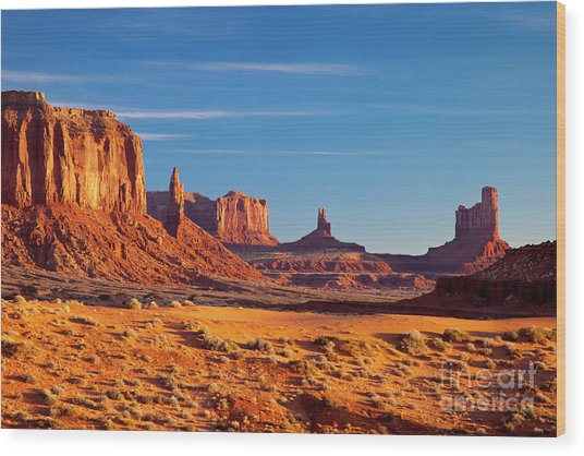 Wood Print featuring the photograph Sunrise Over Monument Valley by Brian Jannsen