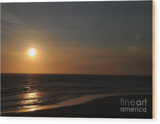 Sunset Over Calm Waters Wood Print