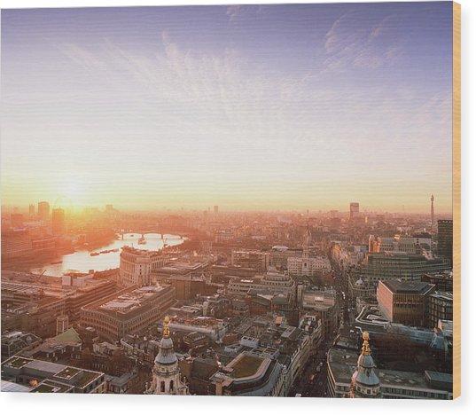 Sunset Over London City Wood Print by Shomos Uddin