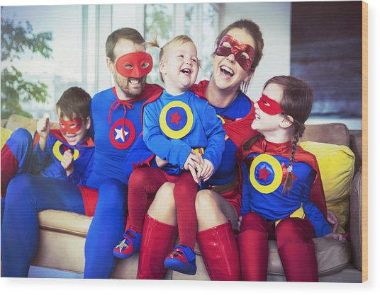 Superhero Family Laughing On Sofa Wood Print by Robert Daly