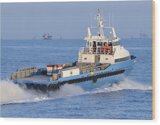 Supply Vessel Heads To Sea Wood Print