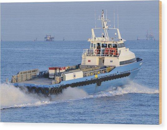 Supply Vessel Heads To Sea Wood Print