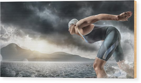 Swimmer About To Dive In Sea Wood Print by Peepo