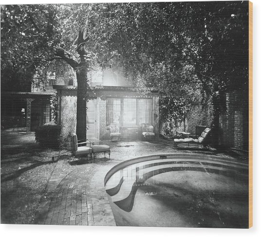 Swimming Pool In Garden At Night Wood Print