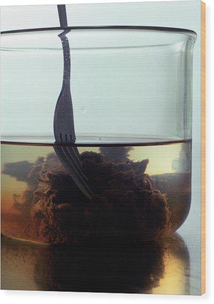 Tamarind Powder Floating In Water Wood Print