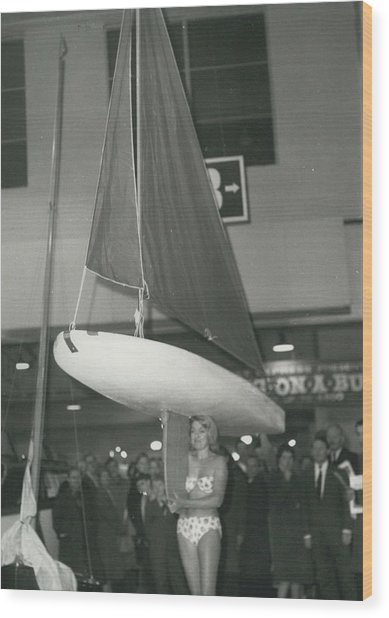 The Girl With A Boat On Her Shoulder. It Weigh Only 40 Les Wood Print by Retro Images Archive