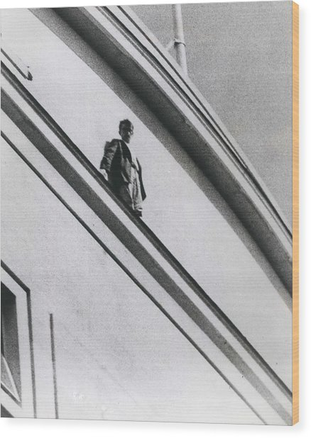 The Man In Love Is Saved From A Parapet Wood Print by Retro Images Archive