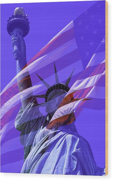 The Statue Of Liberty Draped With The Flag Of The United States Wood Print