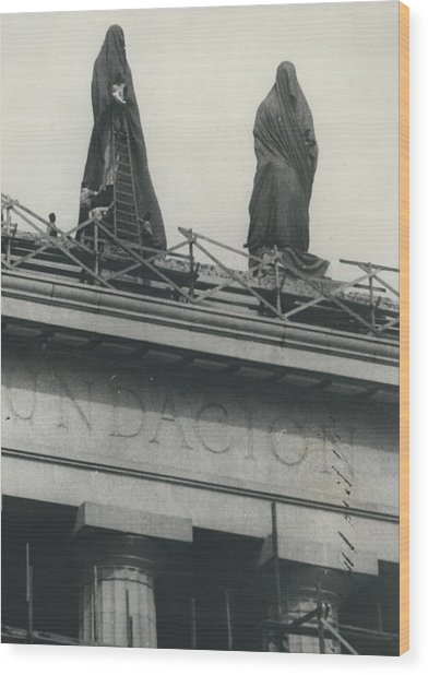 They Don't Like Them Any More; Peron Statues - Covered In Wood Print by Retro Images Archive