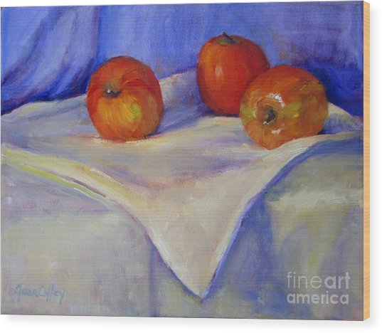 Three Apples With Blue And White Wood Print