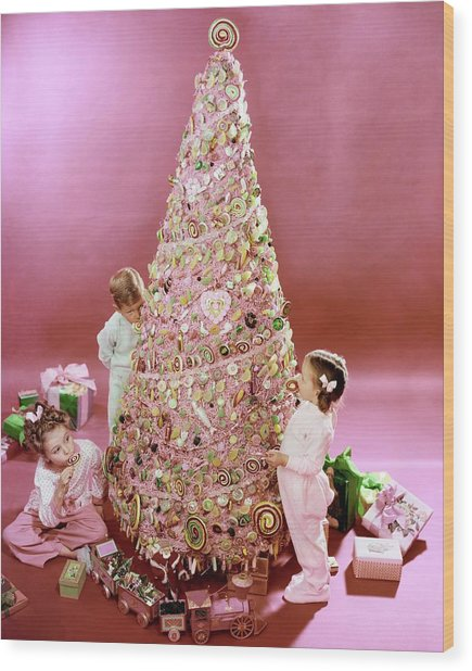 Three Children Eating A Candy Christmas Tree Wood Print by Herbert Matter
