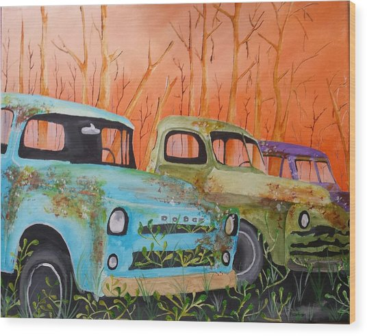 Three Rusty Trucks Wood Print