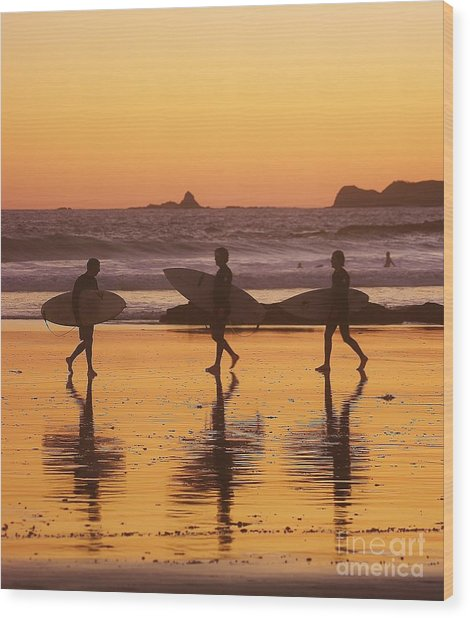 Three Surfers At Sunset Wood Print
