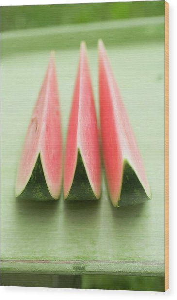 Three Wedges Of Watermelon On Green Table Wood Print