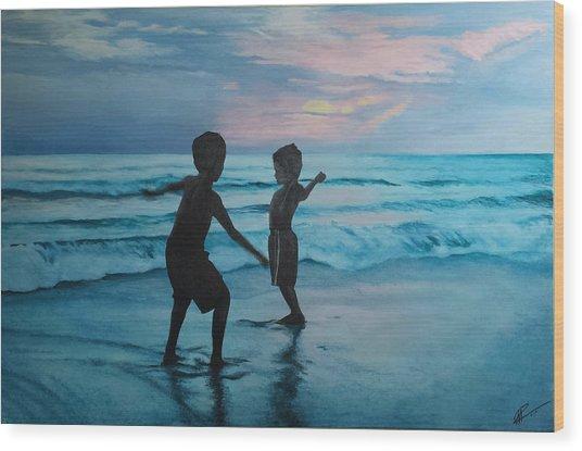 Throwing Sand Wood Print