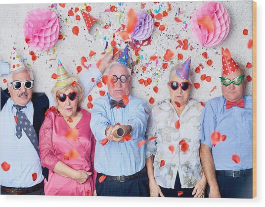 Tired Seniors After Christmas Party Wood Print by Mediaphotos
