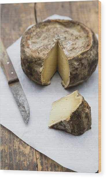 Tomme De Savoie Cheese And Knife On Wood Print by Westend61