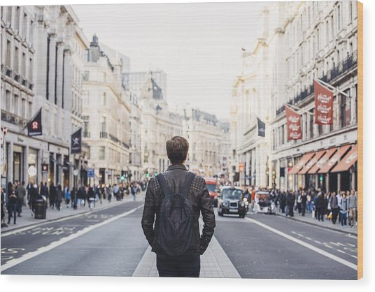 Tourist With Backpack Walking On Regent Street In London, Uk Wood Print by Alexander Spatari