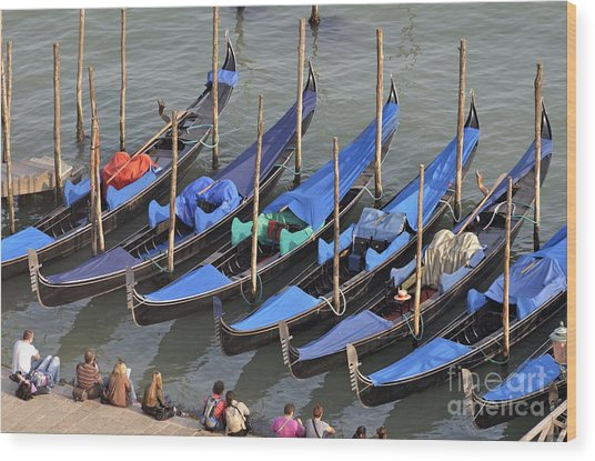 Tourists And Row Of Empty Moored Gondolas Wood Print by Sami Sarkis