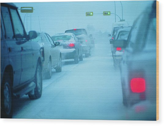 Traffic Jam In Snowy Conditions Wood Print by Digital Vision.