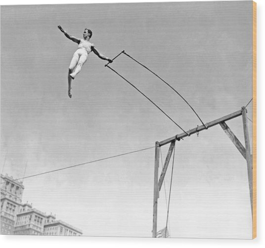 Trapeze Artist On The Swing Wood Print