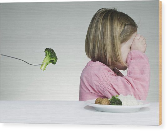 Trying To Get A Child To Eat Her Greens Wood Print by ClarkandCompany