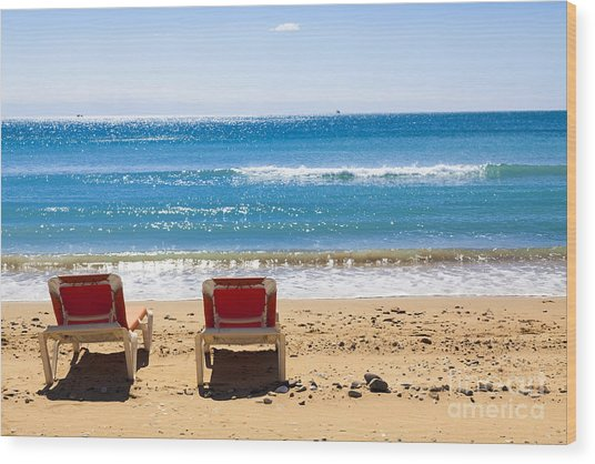 Two Empty Sun Loungers On Beach By Sea Wood Print
