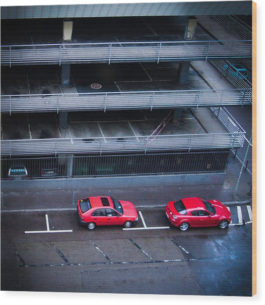 Two Red Cars In The City Wood Print